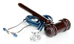 Medical malpractice law. Gavel and stethoscope.