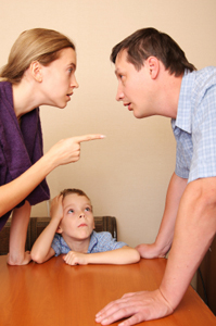 Photo of parents arguing in front of their child