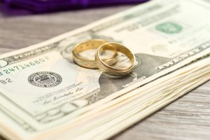 gold wedding rings and money, divorce