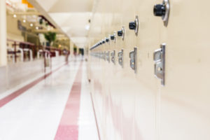 School hallway with rows of lockers