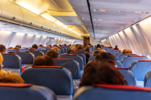Interior of airplane with passengers on seats waiting to taik off